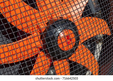 orange fan with safety metal net, close up