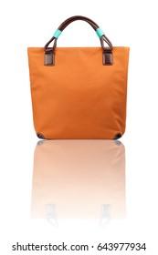 Orange female  handbag on reflected surface.Isolated on white background.Front view.