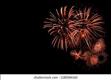 Orange Fireworks with black background