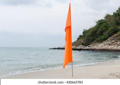 Orange flag on the  Beach
