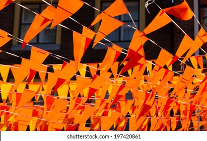 Orange flags during soccer world cup. Flags and color also used at King's day celebrations in Holland.