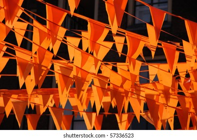 Orange flags during the world cup soccer. Flags and color also used at King's day in Holland.