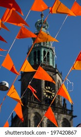 Orange flags (Dutch national color) and martinitoren during world soccer cup. Flags also used on King's day celebrations in Holland.