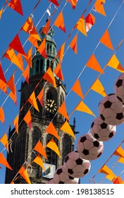 Orange flags (Dutch national color) and the Martinitoren during 2014 world soccer cup.