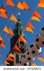 Orange flags and footballs in front of the Martinitoren, Groningen, at the world soccer cup of 2014.