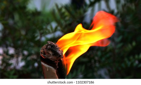 the orange flame of a torch in the night