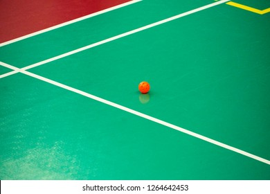 Orange floorball ball on surface