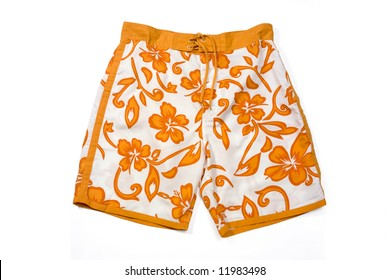 Orange floral pattern swimming trunks isolated on white.