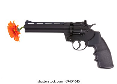 Orange flower hanging from the gun barrel on a white background