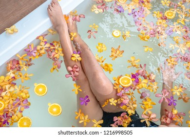 Orange with flowers in the tub