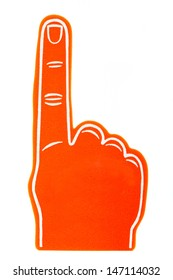 An orange foam fan finger on a white background