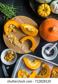 Orange fresh pumpkin cooking with spice and herbs. cut pumpkin slices on a baking sheet. Top view