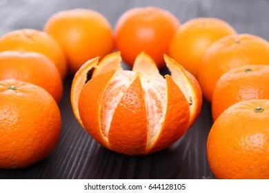 orange fruit citrus tankan against black background