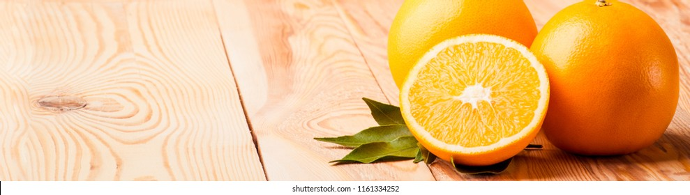 Orange fruit. Fresh citrus organic food on white wooden. Juicy, ripe, sweet vegetarian slice. Yellow color. Half of tasty, healthy, tropical dessert. Natural diet, refreshing. Closeup background.
