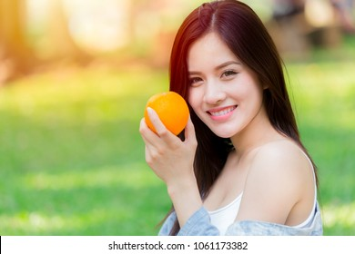 Orange Fruit with Healthy Asian woman for good skin immunity and high vitamin C