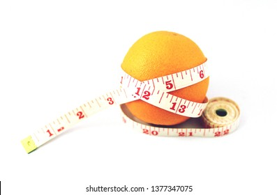 orange fruit with measuring tape isolated on white background.