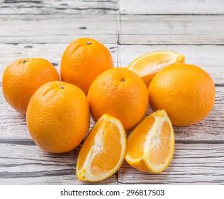 Orange fruit over weathered wooden background