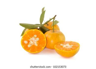 Orange fruit slice with leaves, on white background