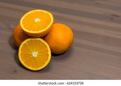 Orange fruit sliced isolated on wood background
