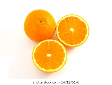 Orange is a fruit that contains vitamins. C. high in orange, cut in half With a shadow on a white background