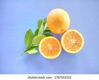 orange fruits isloated on blue background