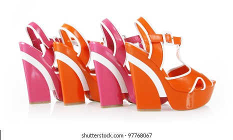 8683b7129 orange and fuchsia colors platform shoes isolated on white
