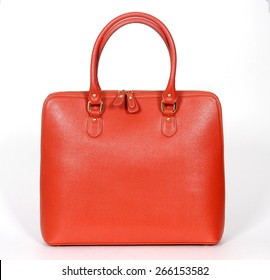Orange genuine leather bag isolated on white background