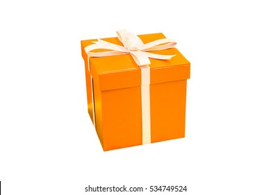Orange gift box isolated on white background. Merry Christmas package paper present wrapped in ribbon bow. Anniversary birthday or happy new year concept