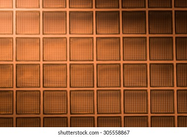 orange glass block wall background with lighting from corner
