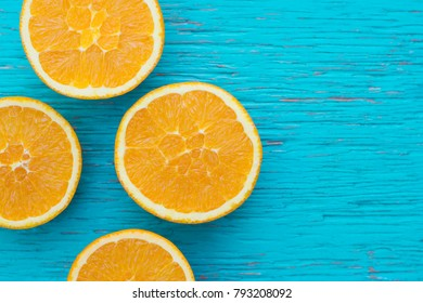 Orange. Glass of orange juice from above on wood table. Empty ready for your orange juice, fruit product display or montage.