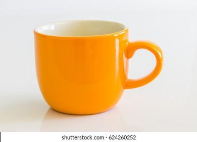 orange glass,coffee cup on white