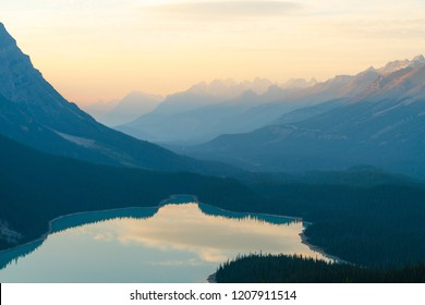 The orange glow of sunset over Peyto Lake in Banff National Park close up