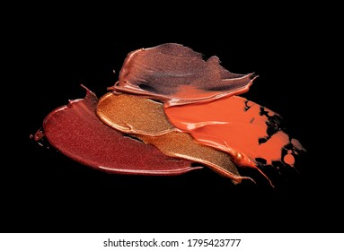 Orange gold brown maroon lip gloss texture smudge black isolated background
