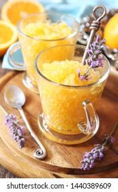 Orange granita, frozen summer dessert and  blooming lavender dressing, selective focus