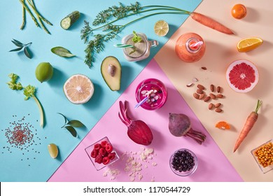 Orange, green and red smoothies from colorful natural vegetables and fruits in a glass bottles with plastic straws on a tricolor background. Top view.