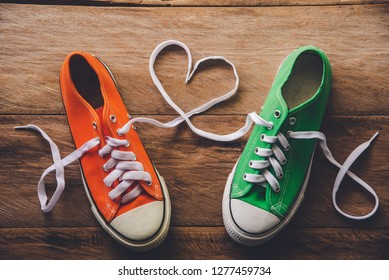 Orange and green sneakers with a rope made of heart style. -Valentine's Day love concept