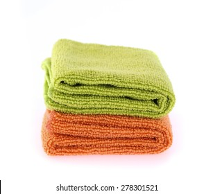 orange and green towel rolls isolated on white background.