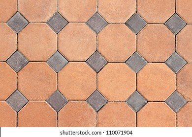 Orange and grey concrete pavings block pattern texture