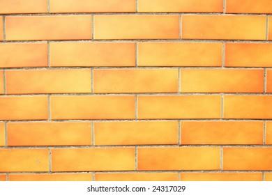 Orange grunge brick wall background.