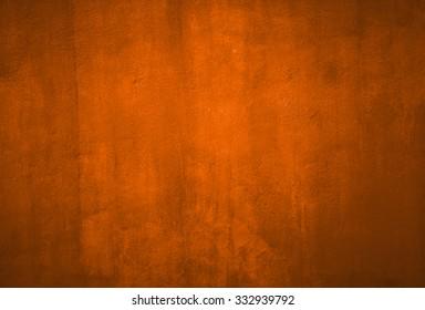Orange grunge textured wall