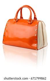 Orange handbag on reflected surface.Isolated on white background.