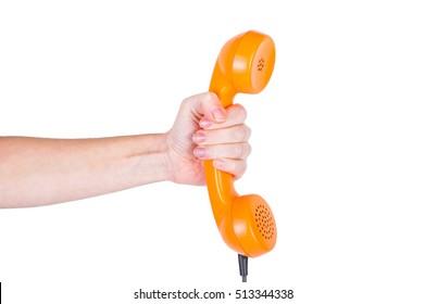Orange handset in hand on a white background