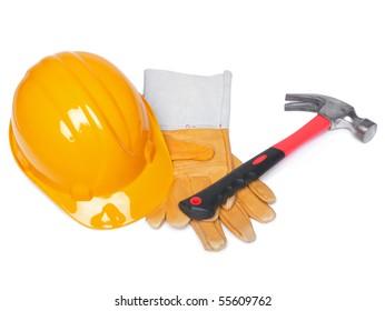 Orange HardHat Hammer And Leather Gloves on white