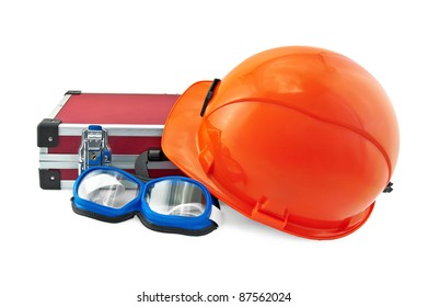 The orange helmet, a red suitcase for tools, safety glasses with black blue isolated on white background