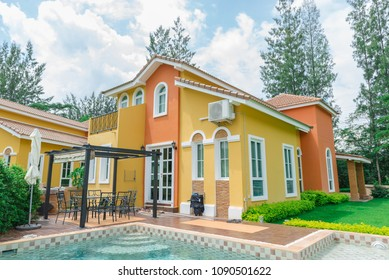Orange home tuscany style in khaoyai resort at nakhonratchasima,vivid,sunny day,beautiful sky