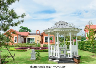 Orange home tuscany style in khaoyai resort at nakhonratchasima,little garden and white wooden pavilion in front home