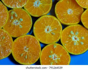 Orange Honey In half plate Blue background.