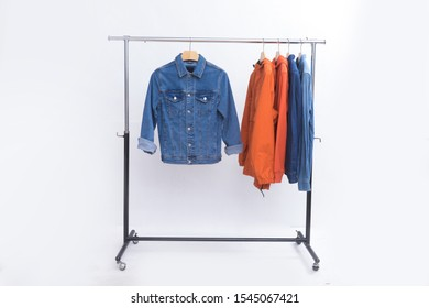 orange hoodie and orange fashion Wind jacket with jeans jacket with blue shirts on hanger