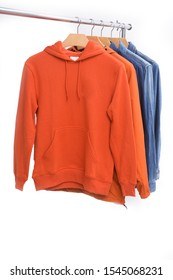 orange hoodie and orange fashion Wind jacket and blue jeans with jeans jacket on hanger