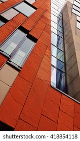 Orange house. Modern architecture. Facade panels. Curtain walls. Glass. Orange. Hamburg